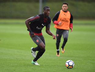 (Photo) Nigerian Starlet Olowu Training With Arsenal First-Team Star Sanchez