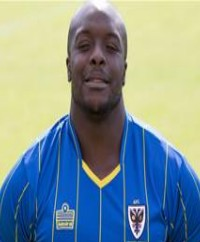 AFC Wimbledon Coach Full Of Praise For His Number Ten Akinfenwa